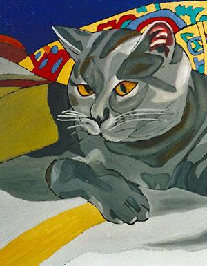 Katze-auf-bunter-Decke_th
